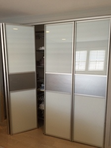 Bi-fold Door BFD-14  White Obscure Glass Pivot Double Doors. (also available as Single Door). Photo
